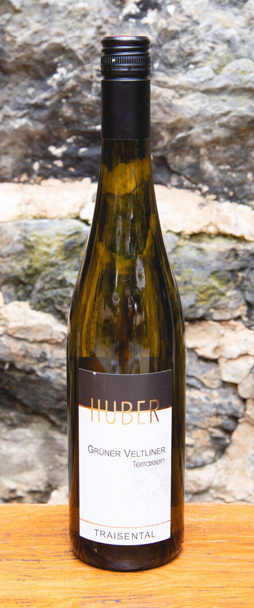 Huber Grüner Veltliner 2018 - Origin: AustriaRetail: $17.95 | Sale: $16.15The Huber family has wine growing roots dating back more than 220 years. They are located in the Trasiental valley, where numerous small-scale agricultural farms have vineyards that are not much bigger than the average family garden.The age of vines and the uniqueness of the soil is an incredible treasure here. This Grüner Veltliner has notes of pear and citrus pith on the nose.The palate does not disappoint, and comes in with beautiful fruit and slight herbal texture. A light, juicy body surrounds a savory core and finishes with dry freshness.Grüner Veltliner 91 Points Wine Enthusiast