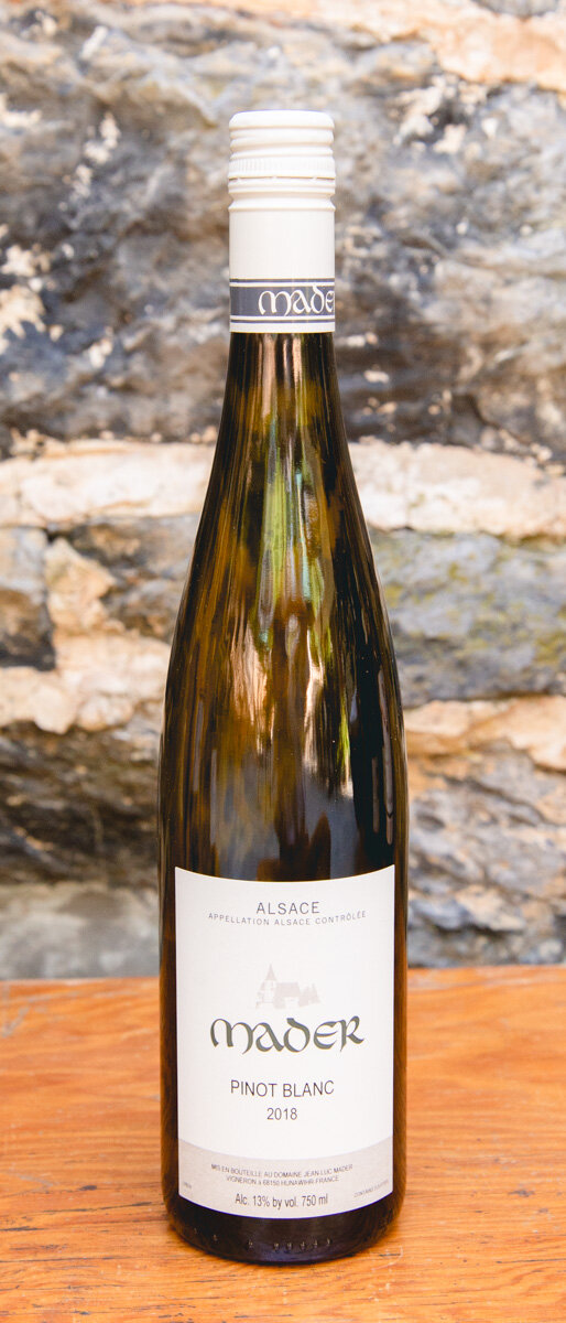 Mader Pinot Blanc 2018 - Origin: AlsaceRetail: $18.95 | Sale: $17.05The Mader domaine is a very small family-owned and operated estate in the village of Hunawihr. After their son earned a degree in Oenology he returned to the family estate and converted all of their vineyards to bio-dynamic viticulture in 2005. For so long Pinot Blanc has been considered as an aperitif wine to start the meal, but a wine of this particular intensity and character is much more than a simple aperitif – it is remarkably complex with wonderful intensity and personality. Classic white flower and citrus aromas lead to a crisp and refreshing palate. It's totally dry but reveals an unusual richness for a Pinot Blanc and the finish is refreshing, thanks to the acidity.Pinot Blanc Biodynamic