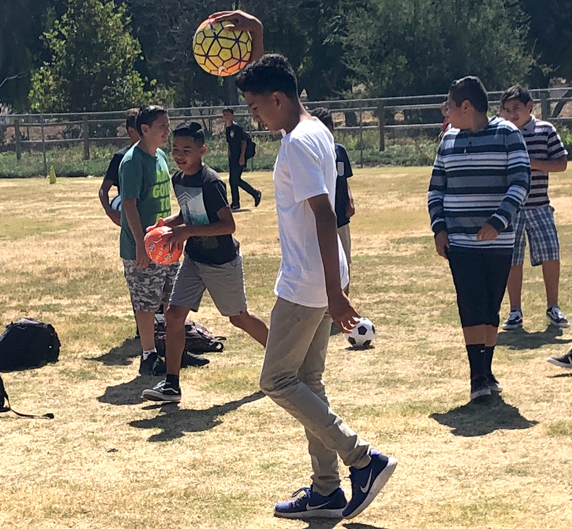 """Arnulfo Zepeda participates in the soccer activity headed by Mr. George Fischer for Fillmore Middle School's """"Sandy Hook Promise: Start with Hello Week."""""""