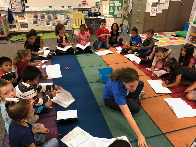 Kinder Teacher Katy Spore gathered her students for journal writing. Part of lessons about social emotional learning at San Cayetano.