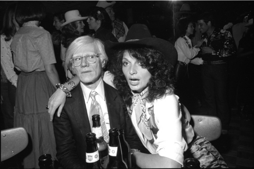 Andy Warhol and Diane Von Furstenberg at the 1980 premiere of Urban Cowboy