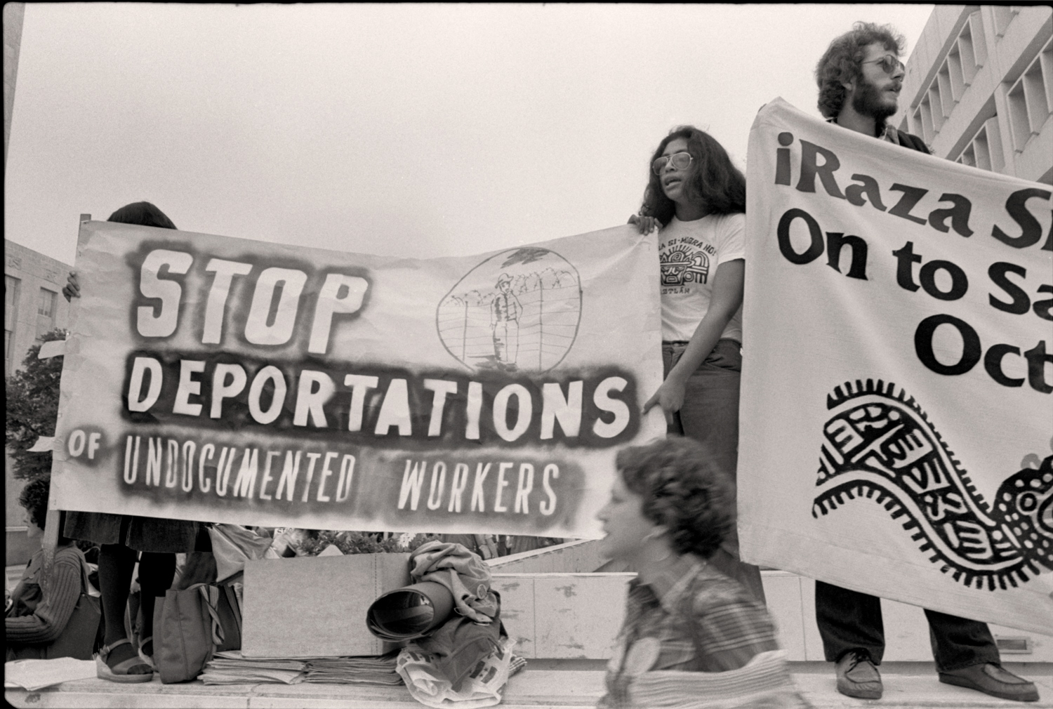 "Houston, 1977 - Outside the Convention Center, large groups demonstrated in support of the rights of immigrants a undocumented workers, who were being exploited and used as a political tool. Ray Marshall, US Secretary of Labor warned in 1977, with regard to discussion of immigration policy, ""there's the danger that some demagogue will feed popular fears."""