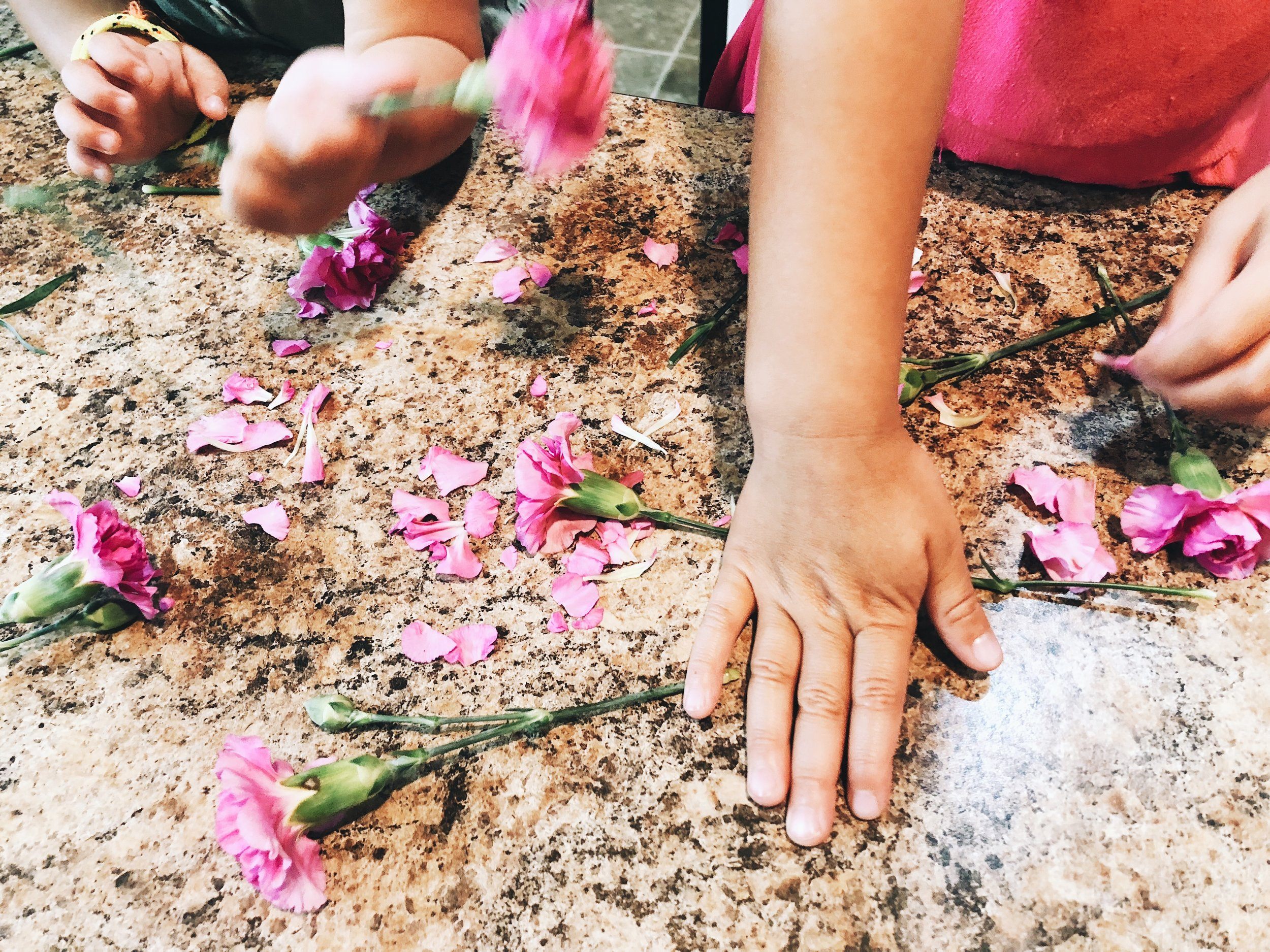 They had to use fine motor skills to rip, pull and tear the leaves and flower petals