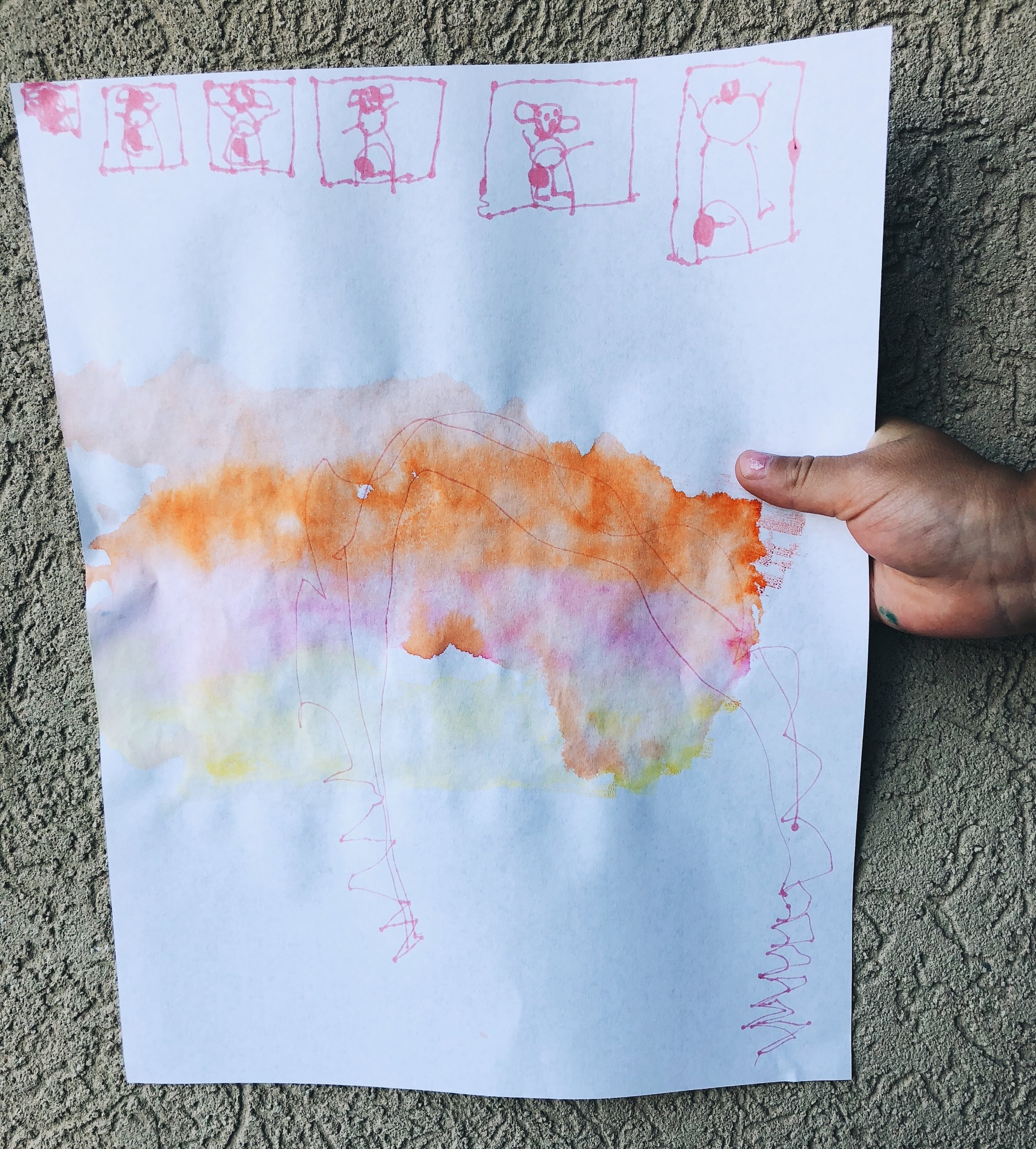 marker water colors first and then 3 year old's drawing of a mountain with people in their homes above.