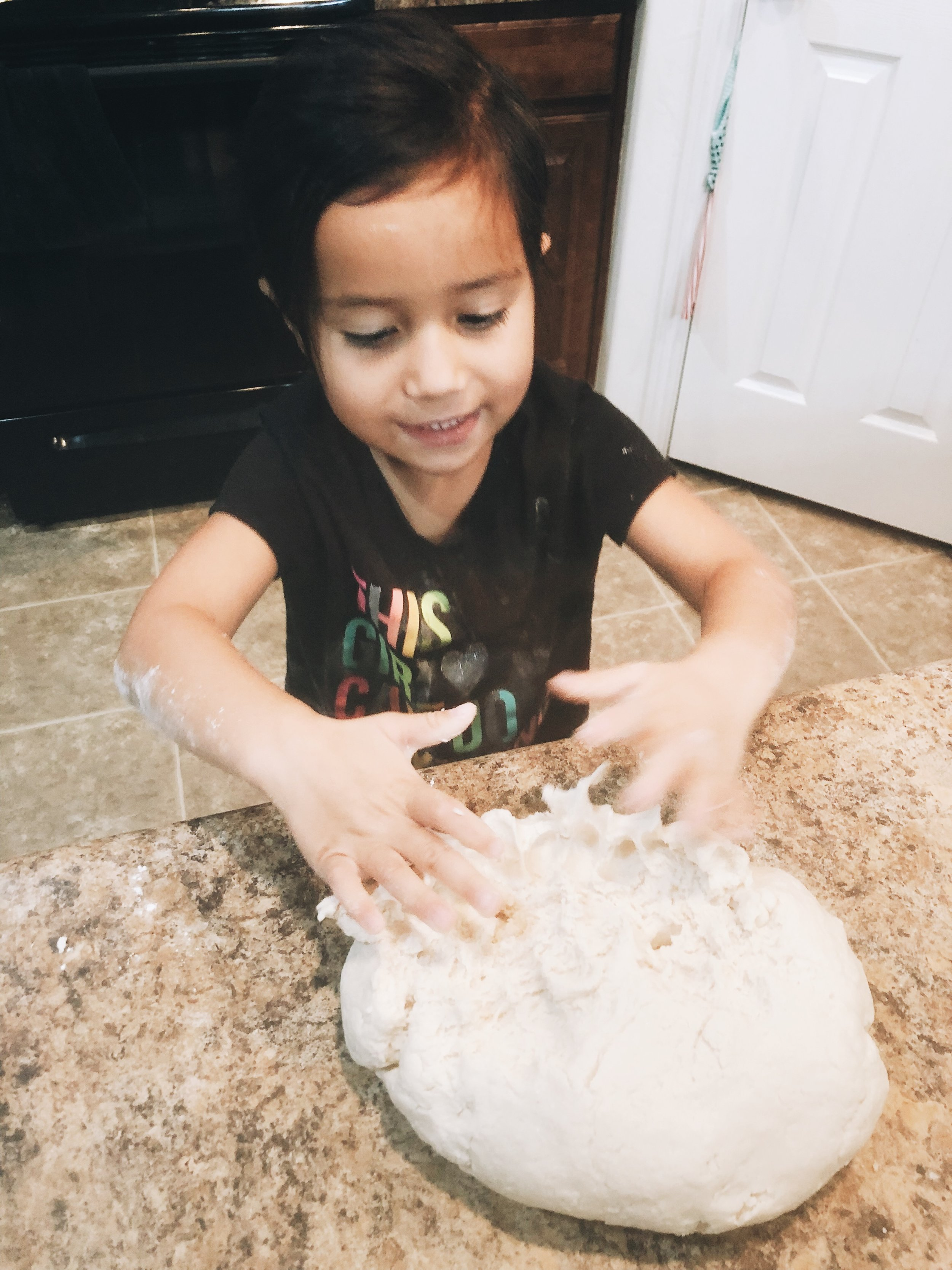 She loved helping me knead the dough!