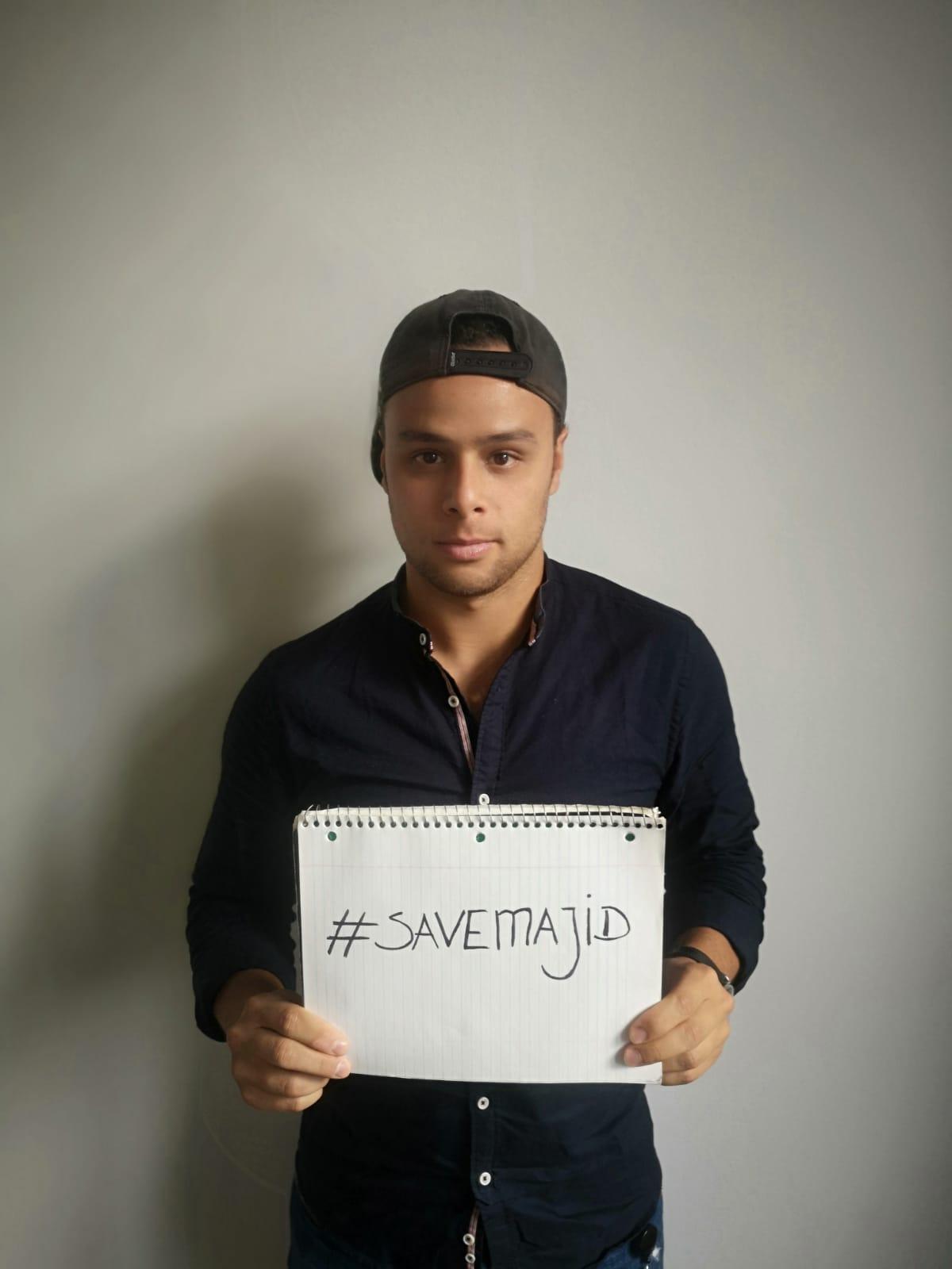Khaled holding sign