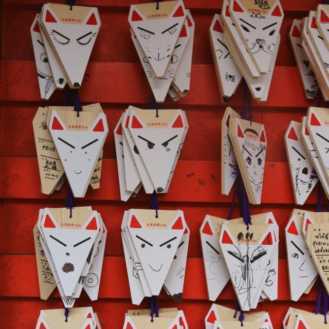 You can buy small wooden plates (ema) at the shrines, write a wish on them and hang it next to the other wishes. These were fox-themed, of course. I liked them so much and you can be sure I bought all the kitsune souvenirs for my friends!