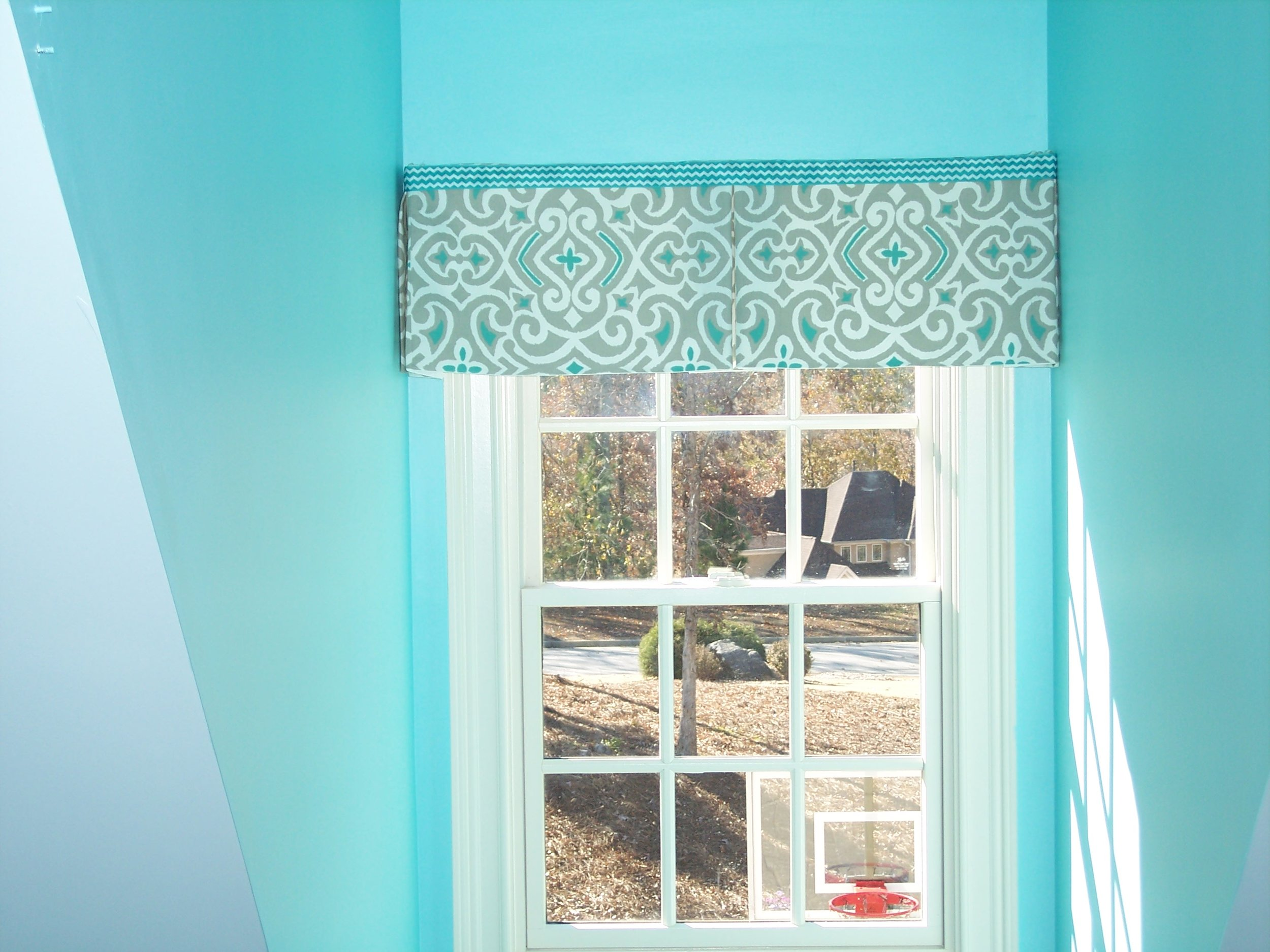 This box pleated valence is the perfect window treatment for this dormer window. Photo courtesy of BK Designs.