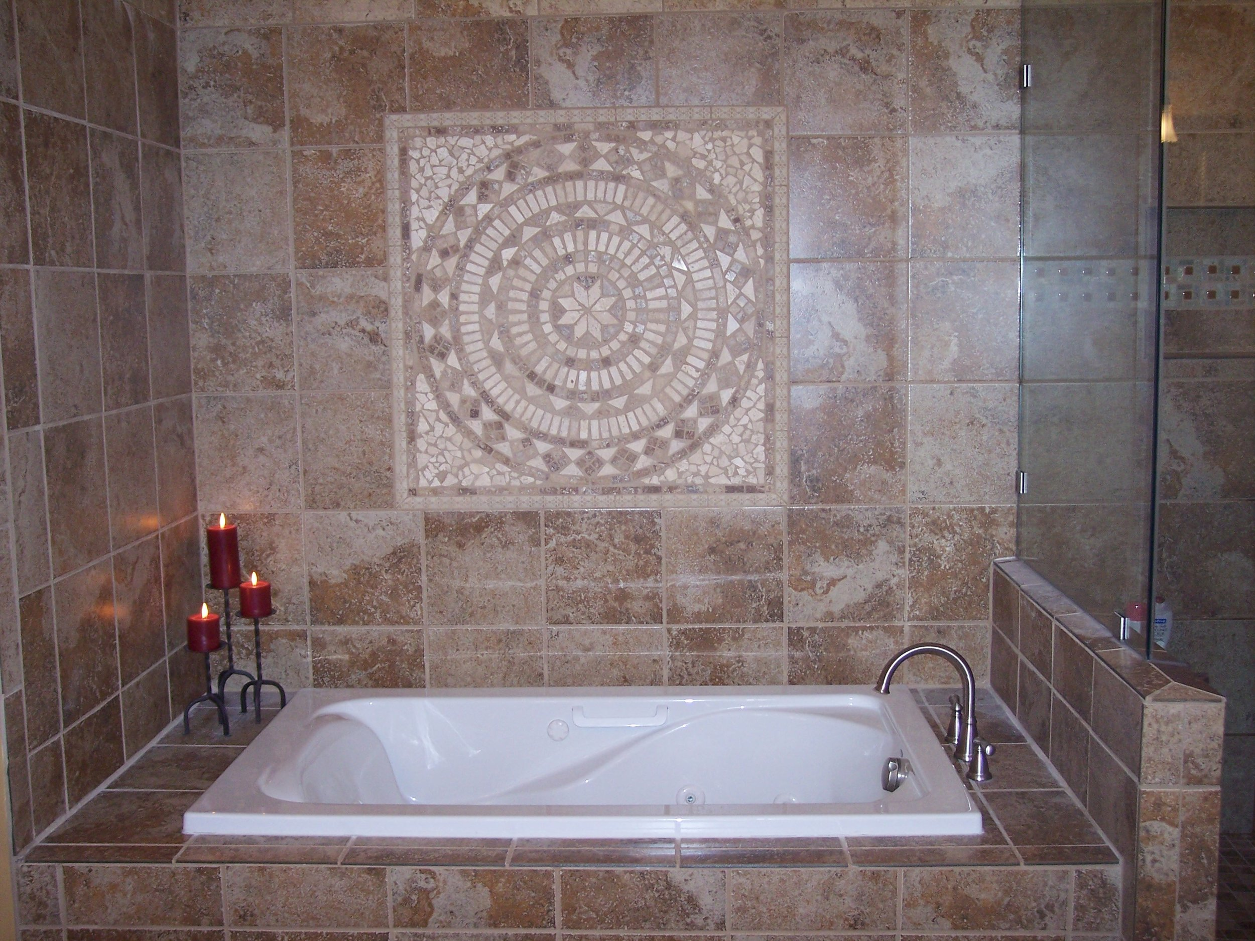 With no window in the main portion of this master bathroom, a tile mural was added.