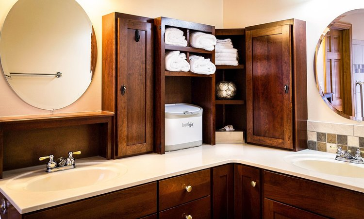 This corner cabinet is great for storage.