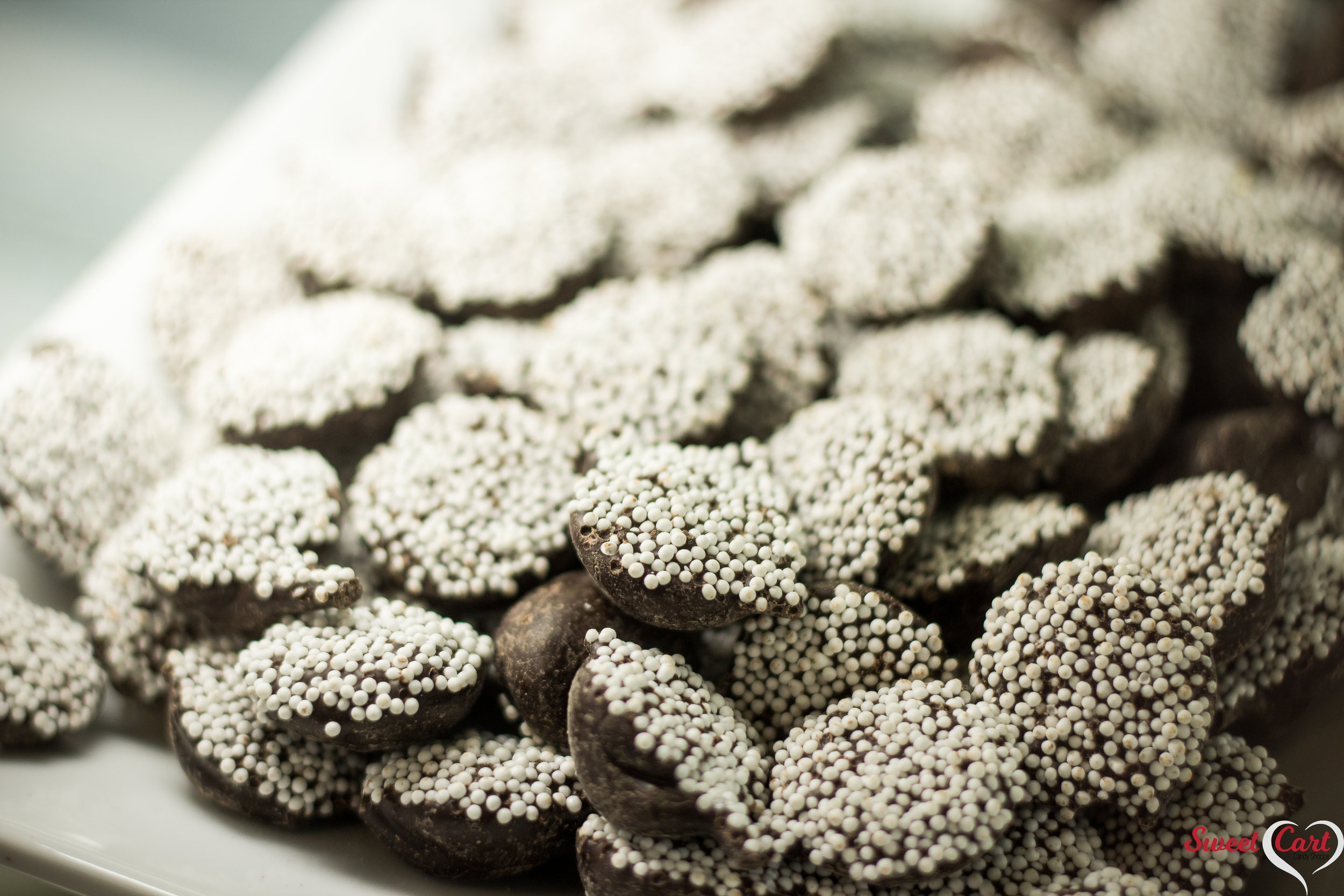 Dark Chocolate Nonpareils   Another classic candy confection! These nonpareils contain delicious Dark Chocolate that is melt-in-your-mouth good.