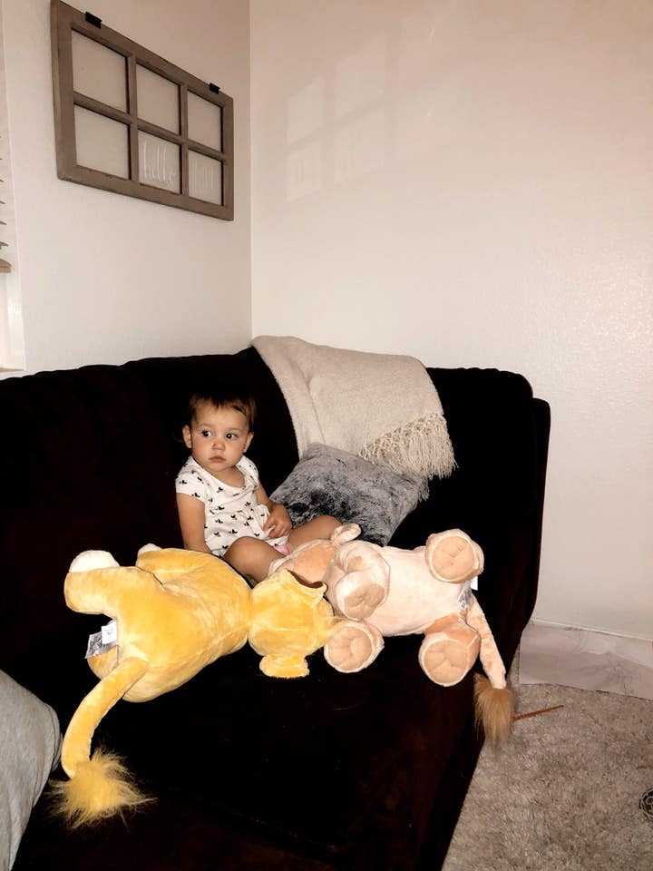 Okay, but how cute is my girl cuddling with Simba and Nala while watching the Lion King?!