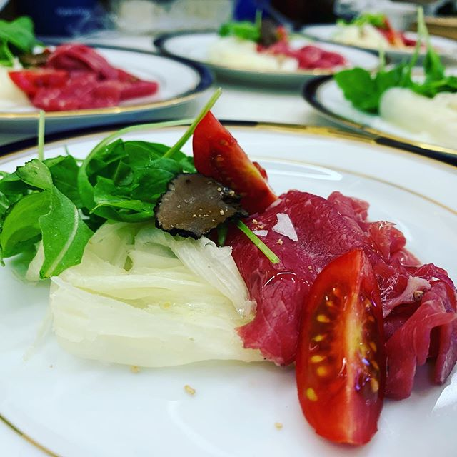 Carpaccio of beef with shaved Italian cheese, arugula salad, shaved truffle and grape seed oil #mediterranean #yachting #food #foodporn #beef #carpaccio #starters #italy #genoa
