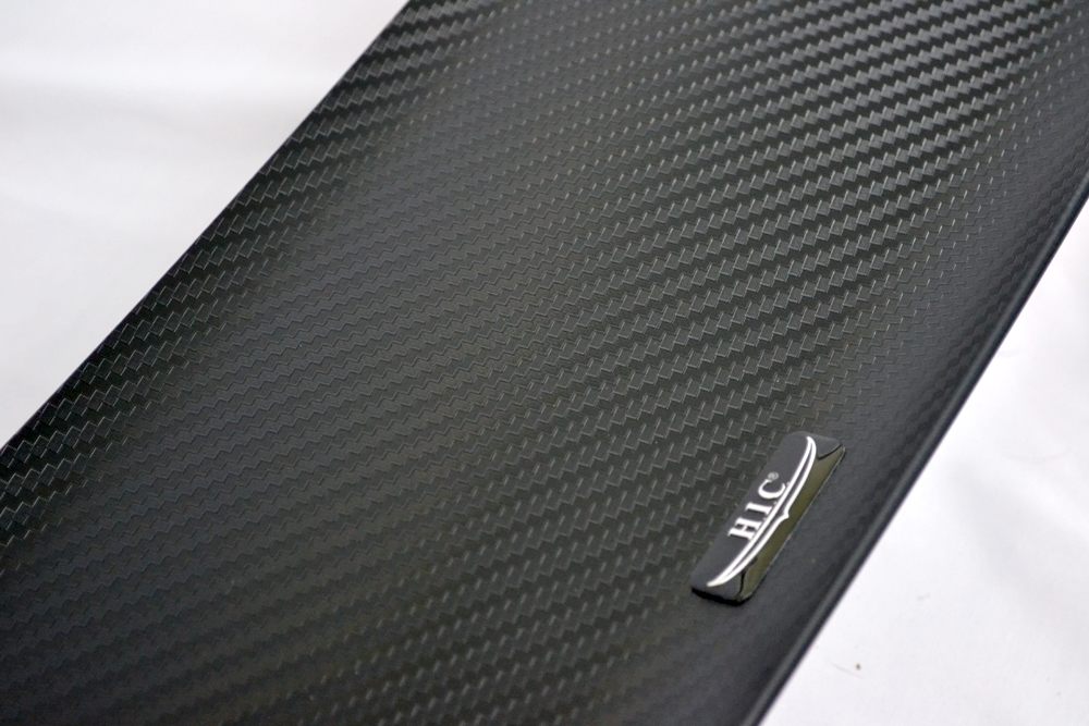 CF Black - 100% injection ABS plastic with molded carbon weave texture