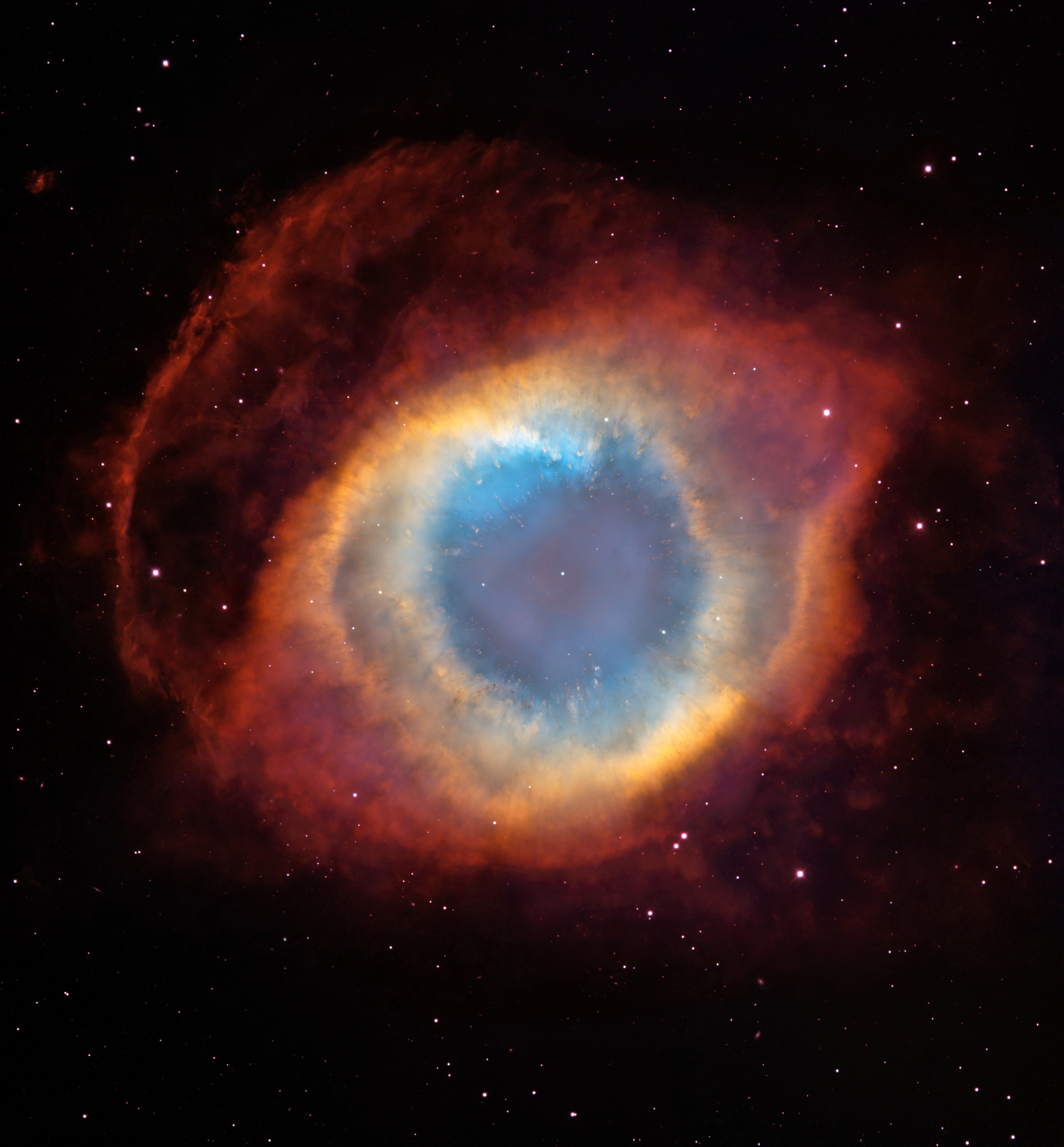 This composite image is a view of the colorful Helix Nebula taken with the  Advanced Camera for Surveys  aboard  NASA / ESA  Hubble Space Telescope and the Mosaic II Camera on the 4-meter telescope at Cerro Tololo Inter-American Observatory in Chile. The object is so large that both telescopes were needed to capture a complete view. The Helix is a planetary nebula, the glowing gaseous envelope expelled by a dying, sun-like star. The Helix resembles a simple doughnut as seen from Earth. But looks can be deceiving. New evidence suggests that the Helix consists of two gaseous disks nearly perpendicular to each other.   Credit:   NASA ,  ESA , C.R. O'Dell (Vanderbilt University), and M. Meixner, P. McCullough, and G. Bacon (  Space Telescope Science Institute )