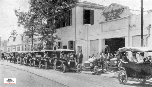 1915 photo from  Ford Times . Note the two T speedsters emerging from the garage!  photo courtesy Larry Sigworth collection