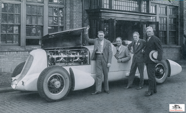 1935 Duesenberg Special. Seated is Jenkins, with designer Augie Duesenberg standing at left and Harvey Firestone at right.  photo from Jenkins Family Collection, courtesy Gordon Eliot White