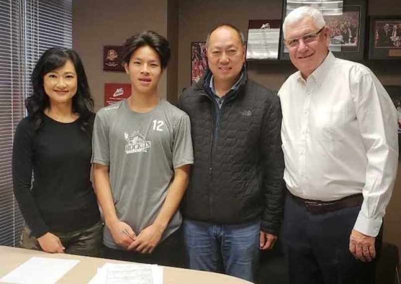 Trevor Wong with his parents and Kelowna Rockets GM Bruce Hamilton after signing his WHL standard player agreement. The 15-year-old had a verbal agreement with the University of Denver before opting for the major junior route.  Photograph By WHL ROCKETS