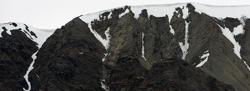 "ABOVE:  All These Boundaries  (Southern Fjortende Julibukta-14th of July Glacier, 79°07'2""N, 011°51'1""E, June 13, 2017)    BELOW:  A False Sense of Isolation  (Ytre Norskøya-Outer Norway Island, 79°51'44""N, 011°26'8""E, June 17, 2017) Chromogenic photograph, 72x26"", 2017."
