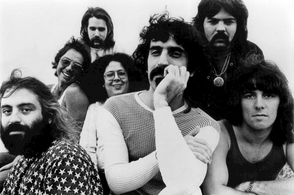 Zappa with the Mothers, 1971 . Publicity photo of Frank Zappa and The Mothers of Invention, Herb Cohen Management. (Public domain).