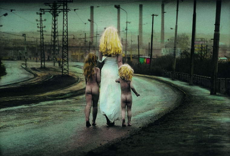 Jan Saudek ,  Destiny Walks Down to the River, Leading Two Innocent Children , 1969, (and a later hand-tinted version) (© Jan Saudek, courtesy Taschen)
