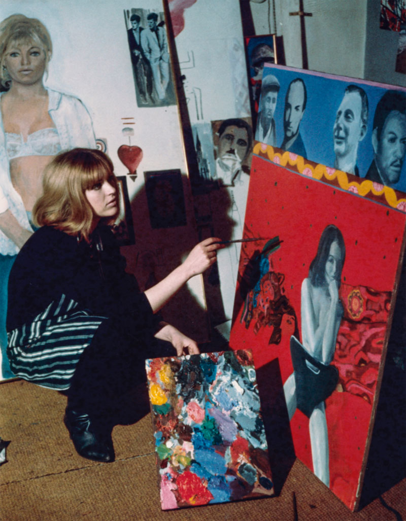 Artist Pauline Boty  in 1964 with lost painting  Scandal 63 . © Michael Ward Archives / National Portrait Gallery, London.