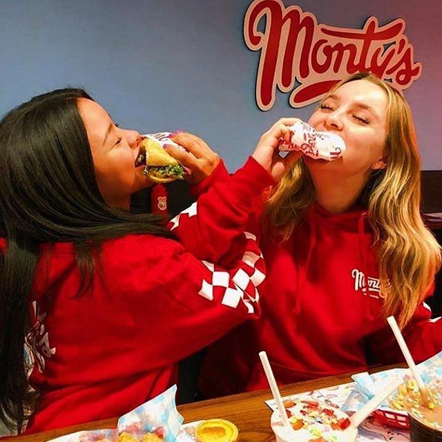 @cierraramirez and @alexalosey in the Red Monty's Hoodie available online now! • • • #montysgoodburger #impossiblefoods #ktown #plantbased #vegan #burger #veganburger