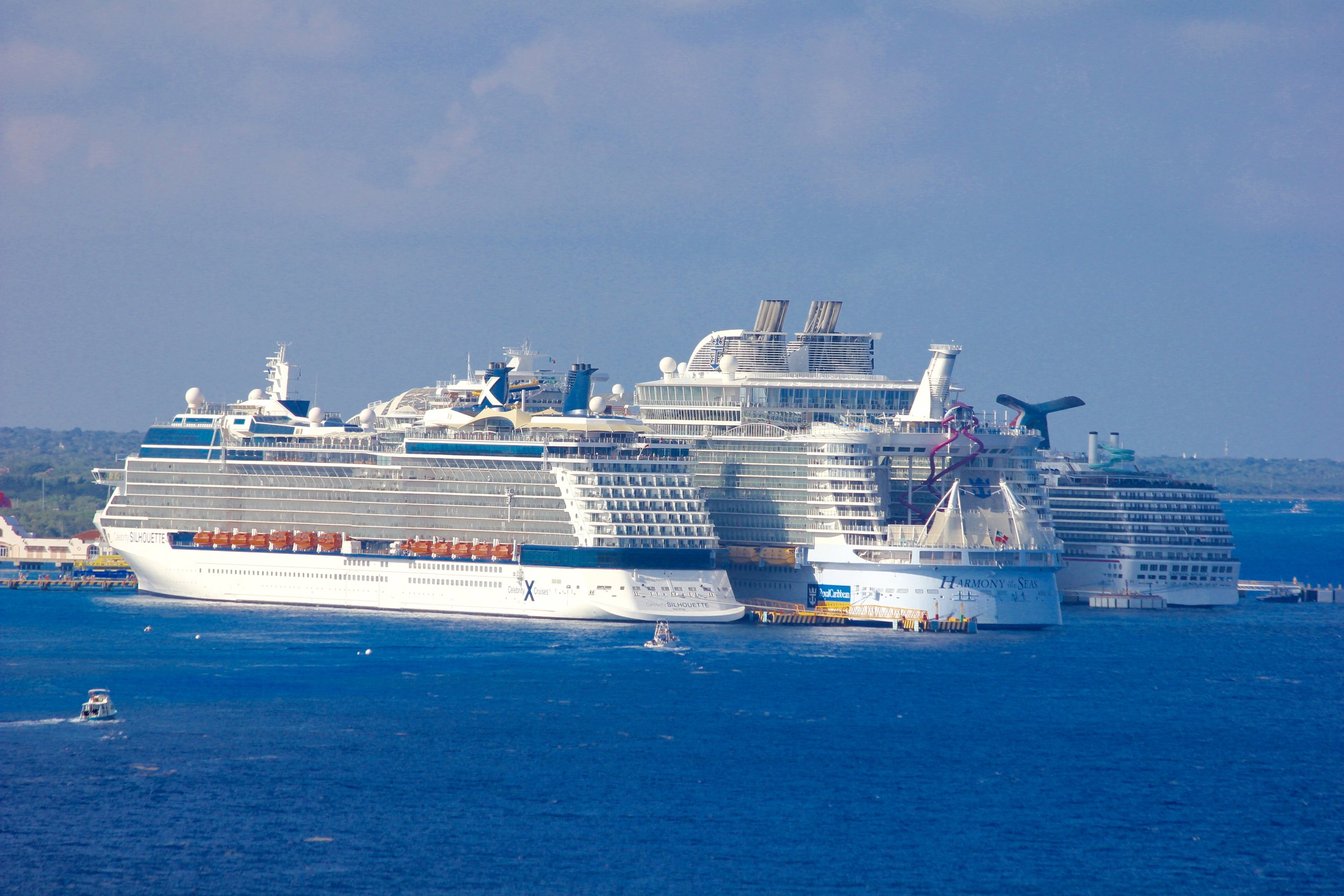Celebrity Silhouette, Harmony of the Seas, Carnival Miracle, and Carnival Fantasy