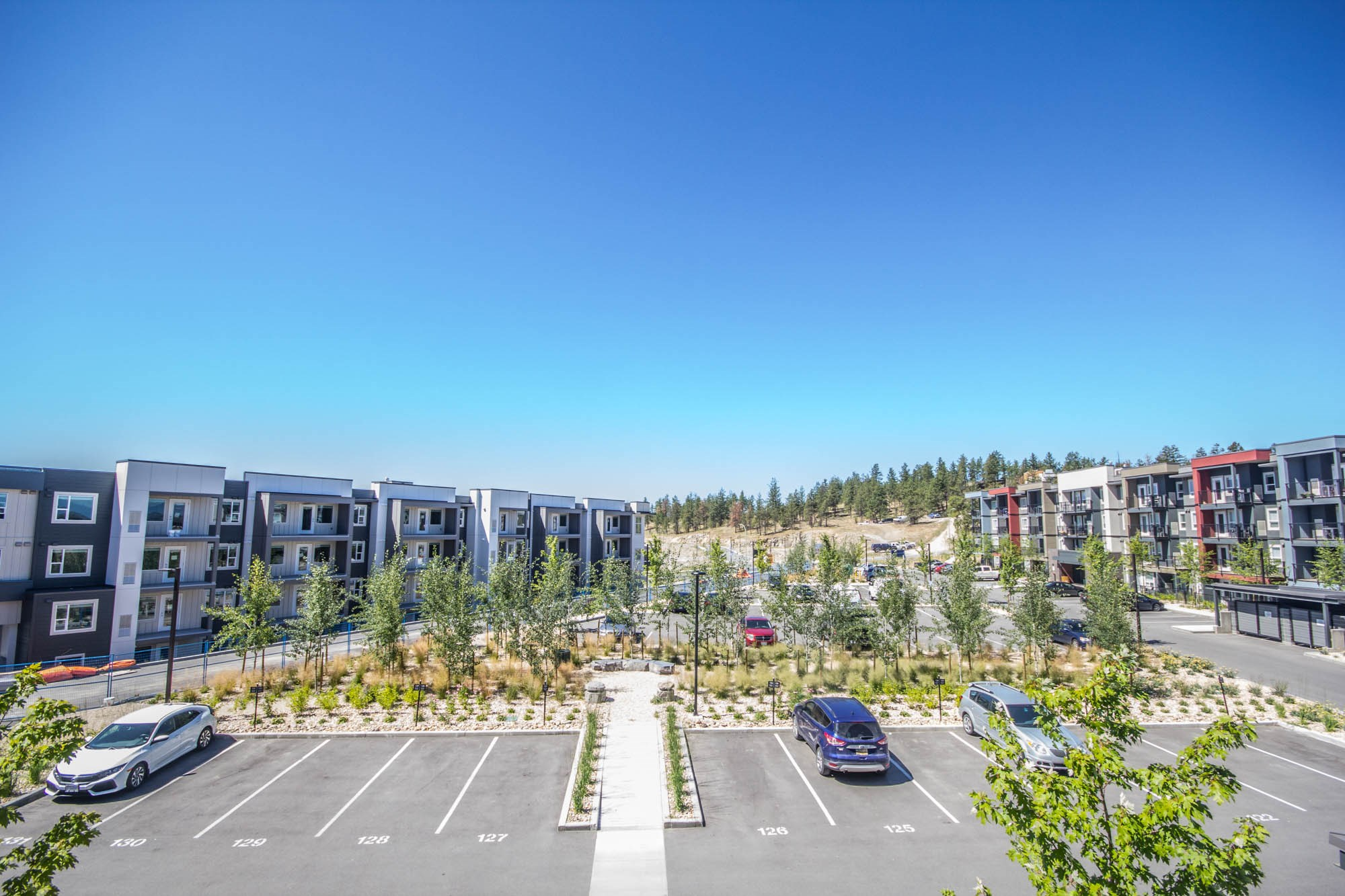 775-academy-way-u-three-ubco-kelowna-investment-property-parking-lot.Jpg