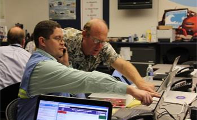 Bennett Cummings, left, during an exercise at the Emergency Operations Center.