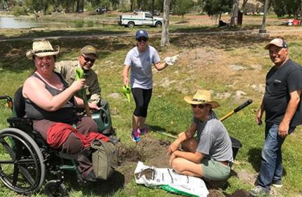 Sarah Panfil, left, at ERG tree planting event.