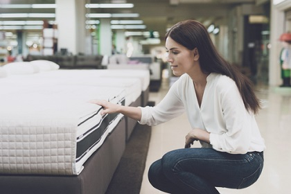 Woman checking out mattresses