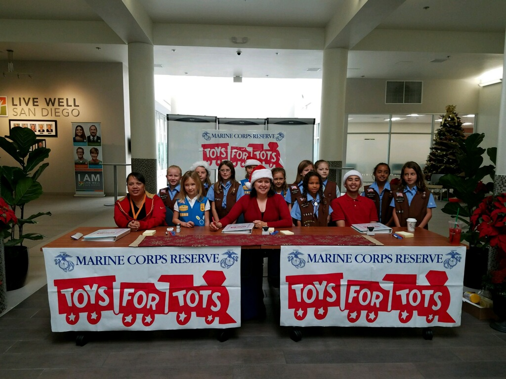 HHSA EMPLOYEES AT THE nORTH inLAND lIVE wELL CENTER, LOCATED IN THE eSCONDIDO lIVE WELL CENTER, HAD SOME HELP DISTRIBUTING TOYS FOR TOTS FROM A LOCAL GIRL SCOUT TROOP.