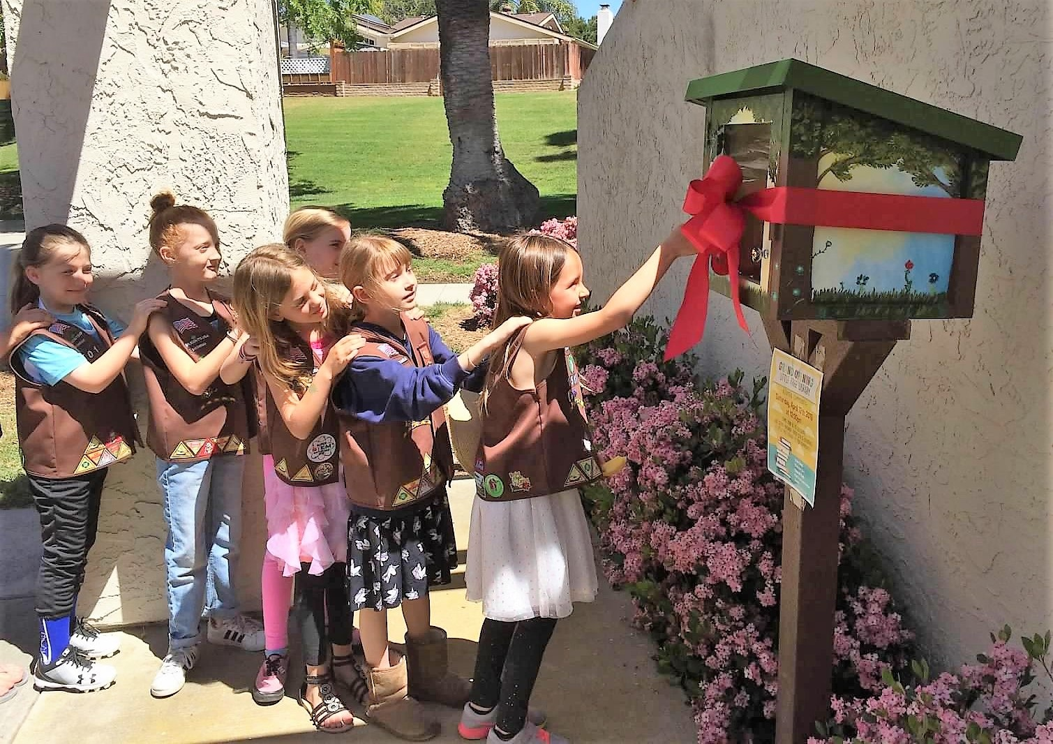 Girl Scout Brownie Troop 1501, led by County employee Melissa Bartolome, used money from cookie sales to donate a Little Free Library to the Altamira community in Carlsbad