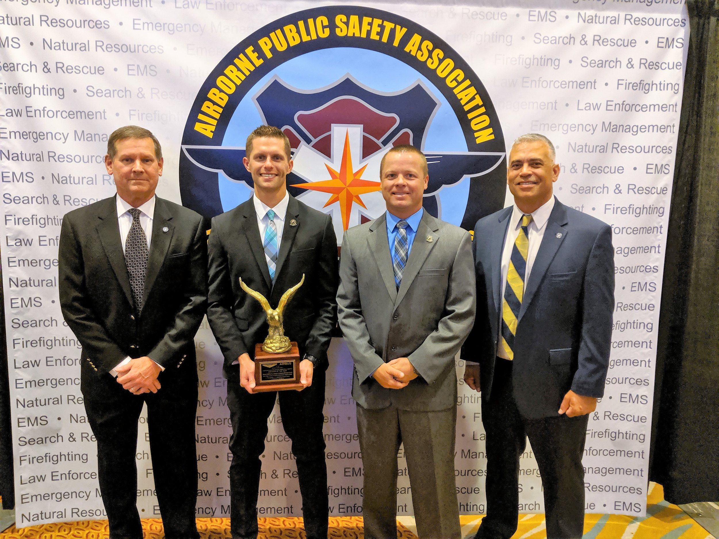 Deputies Bill Liniewicz (center left) and Michael Davis (center right) at the APSA ceremony on July 19.
