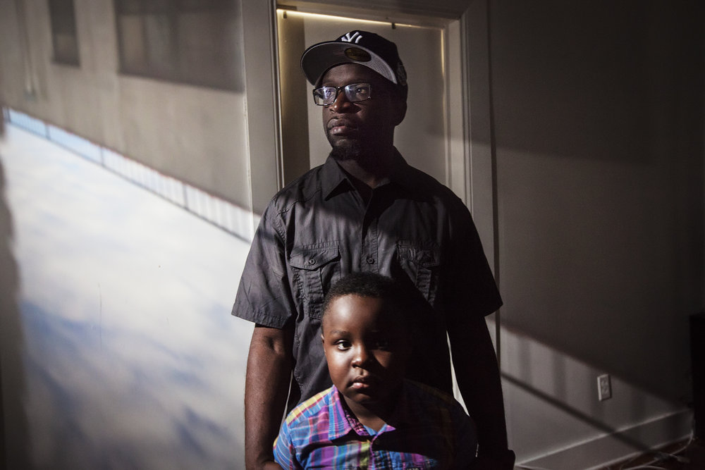 "Clifton, 35, poses for a portrait with his son, Logan Suttor, in East New York, NY on March 12, 2016. ""Being a father is just not a title, it's a job. It's a full time job until the day you die."""