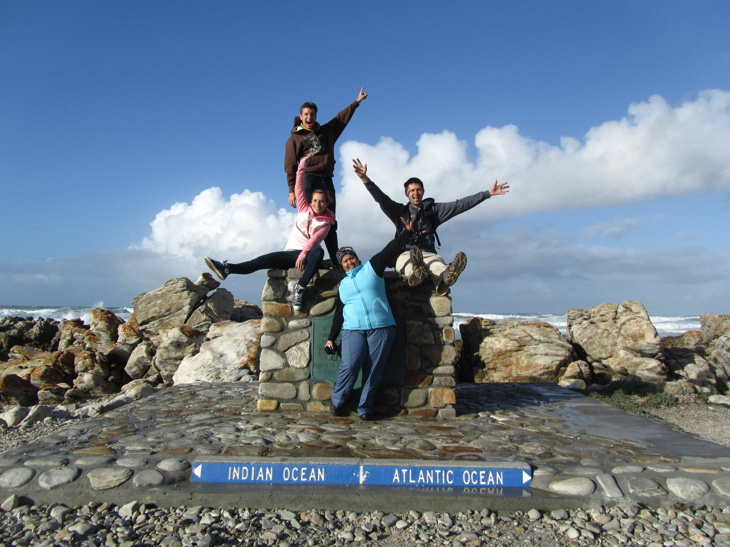 LAL-CPT-Travelling-Classroom-TC-Cape-Agulhas-group-shot-open-arms-2012-min.JPG