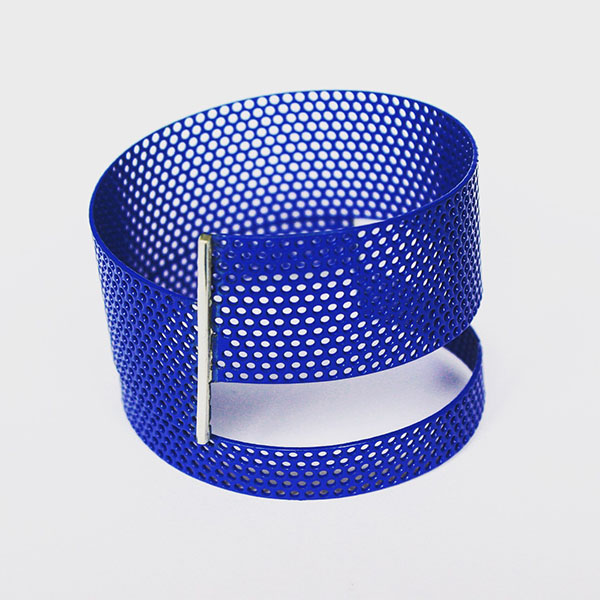 The original one which enabled the perforated mild steel bangle series.  Blue powder coated perforated mild steel with silver. 2015