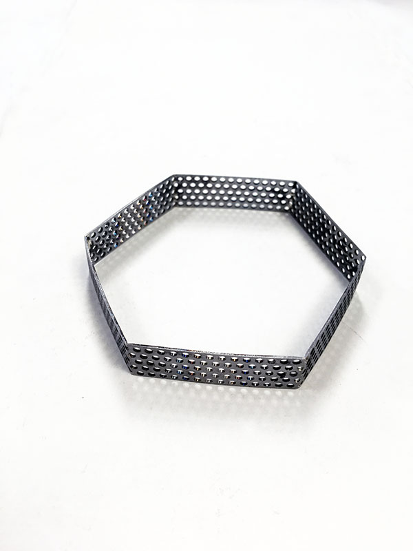 Hexagon bangle formed and before powder coated. Perforated mild steel