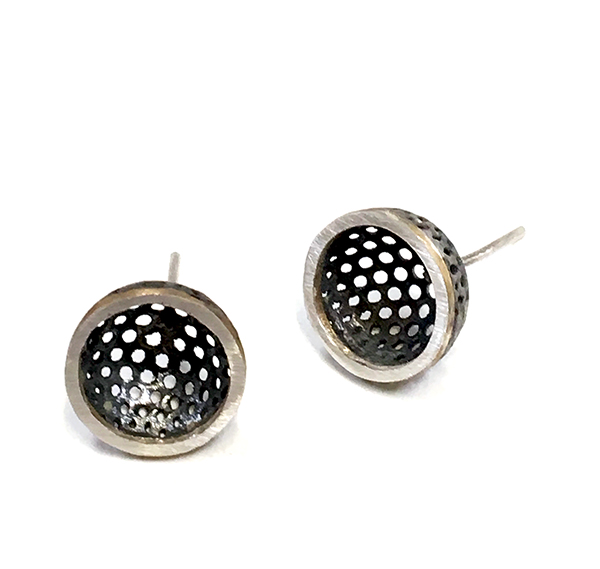 Perforated mild steel cup with silver rim stud earrings.