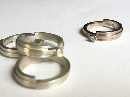 silver rings with 18k white gold ring.