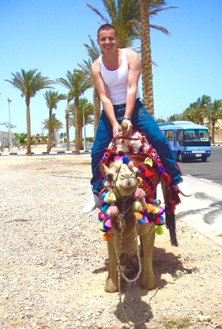 Ian riding a camel in Sharm el Sheik, Egypt.