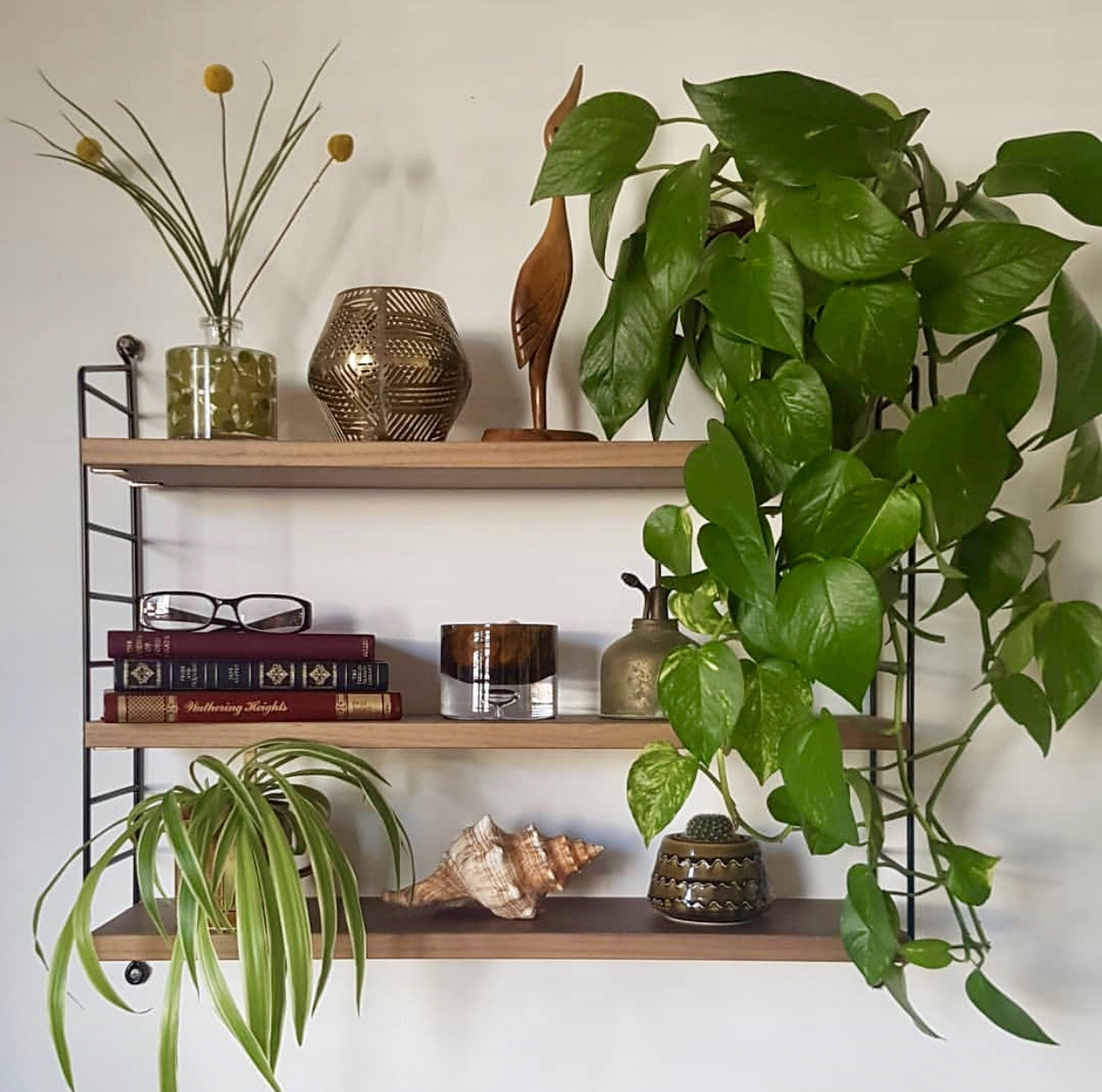 A beautifully styled Shelfie from the Queen of the Pocket String Shelf  @nnekabolaji
