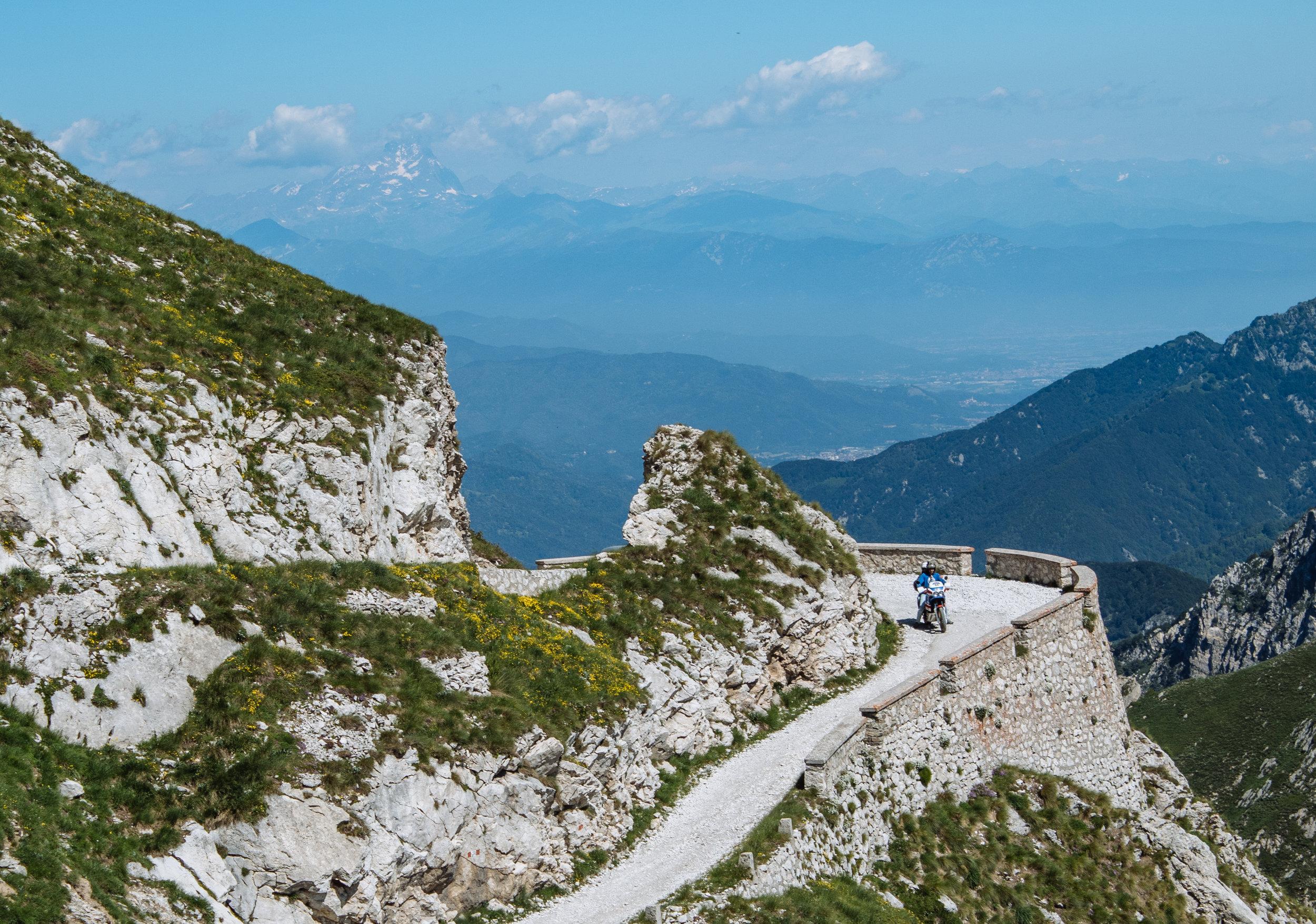 Mt Viso overlooking a cornering biker