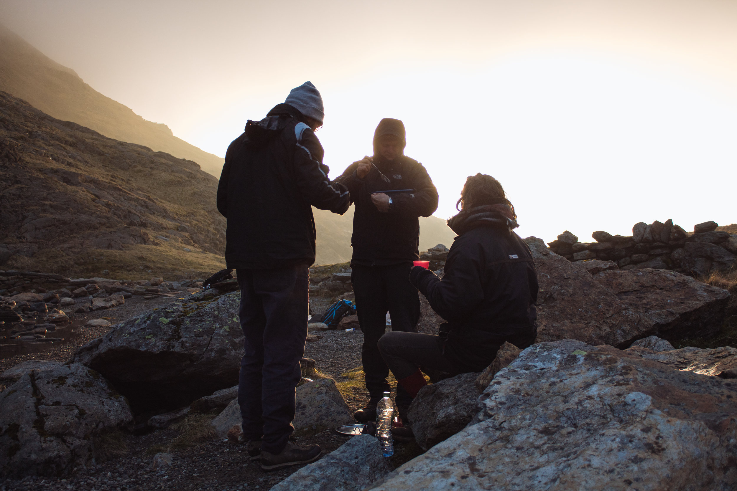 Arguing over how porridge is made best, just after sunrise, as we prepare to summit Snowdon.
