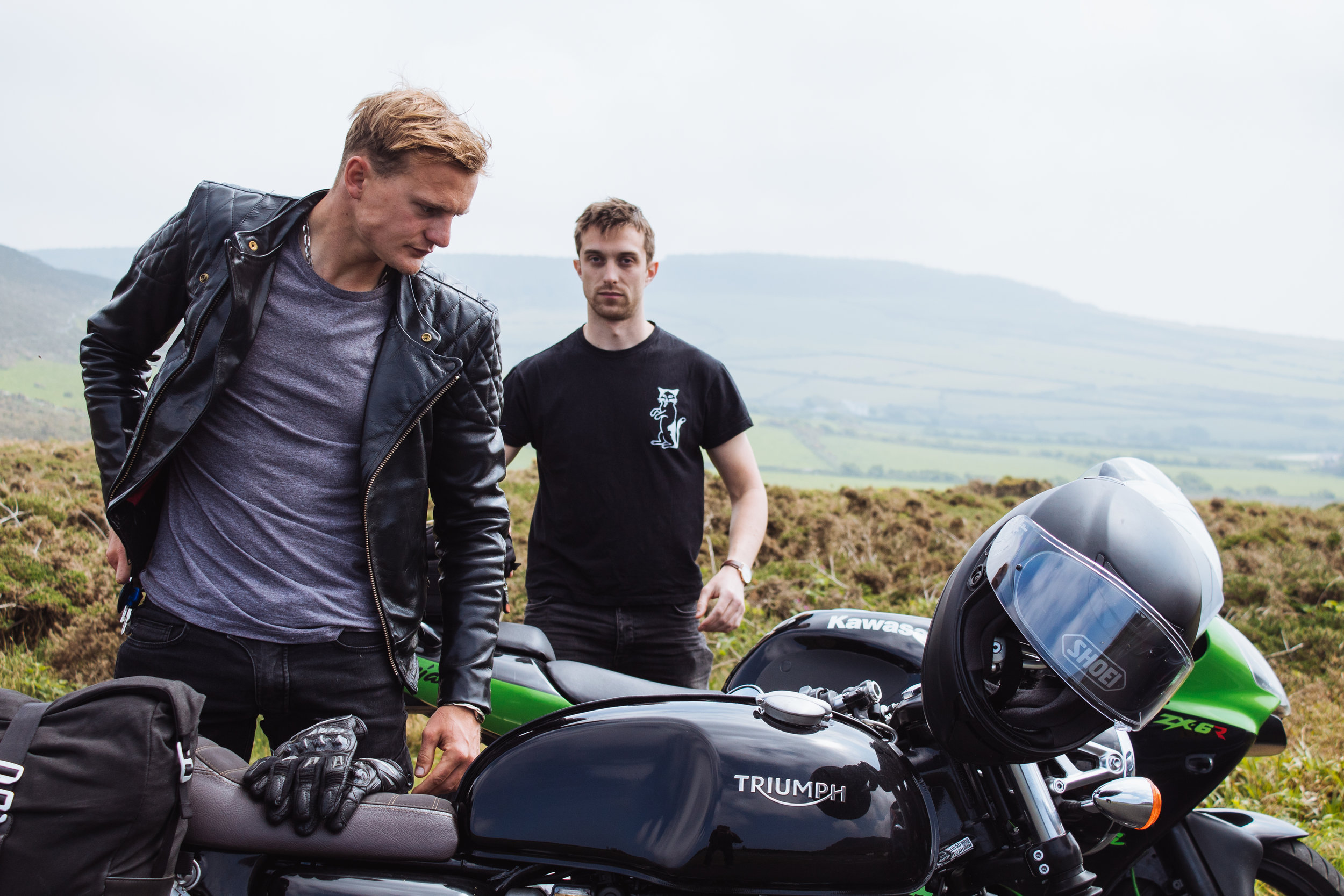 Jo with his Triumph Thruxton, and Charlie with his Kawasaki Ninja