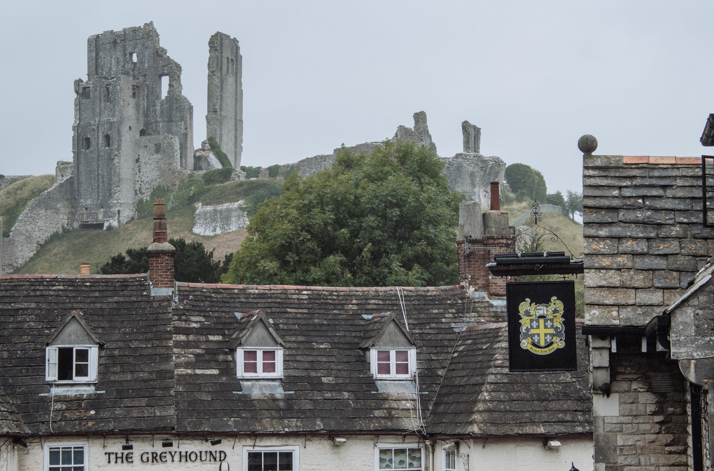 Corfe castle above an english pub