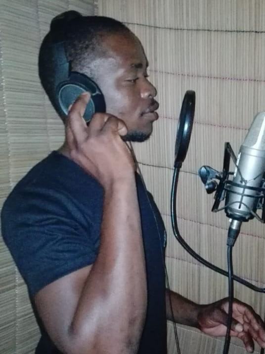 Leader of Os Nweti laying the vocal tracks on his original song of solidarity.