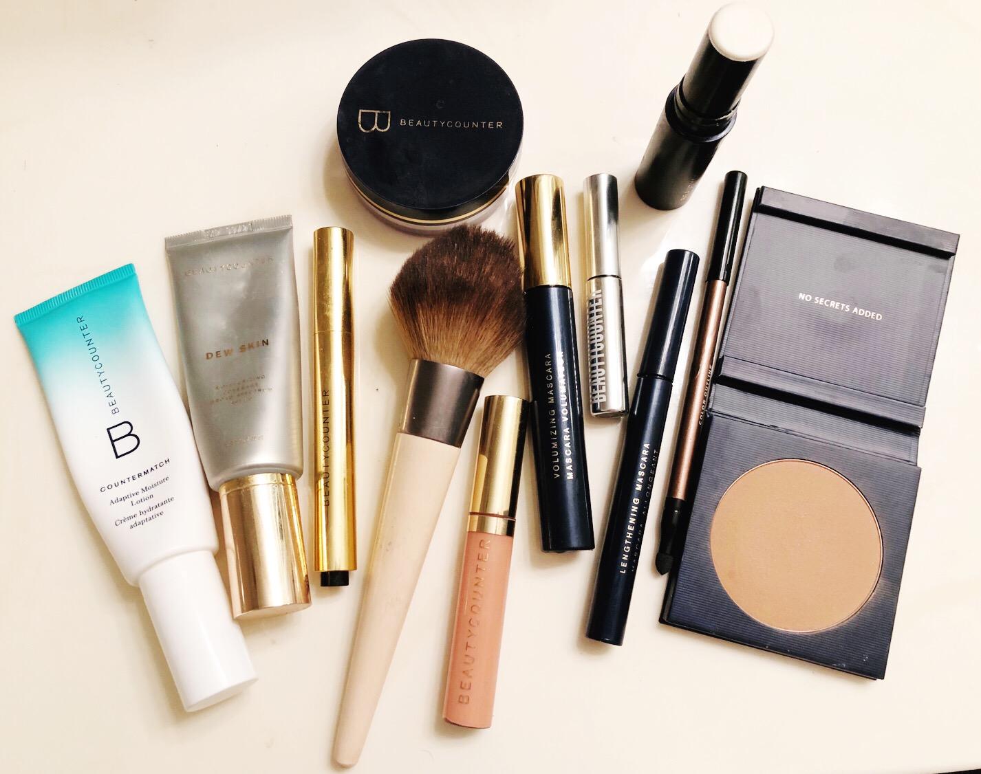 Left to right:    Adaptive Moisturizer   ,    Dew Skin   ,    Concealer Pen   ,    Mattifying Powder   ,    Lip Gloss,       Volumizing Mascara   ,    Brow Gel   ,    Lengthening Mascara   ,    Eyeliner Pen   ,    Highlighter Stick   ,    Bronzer   .