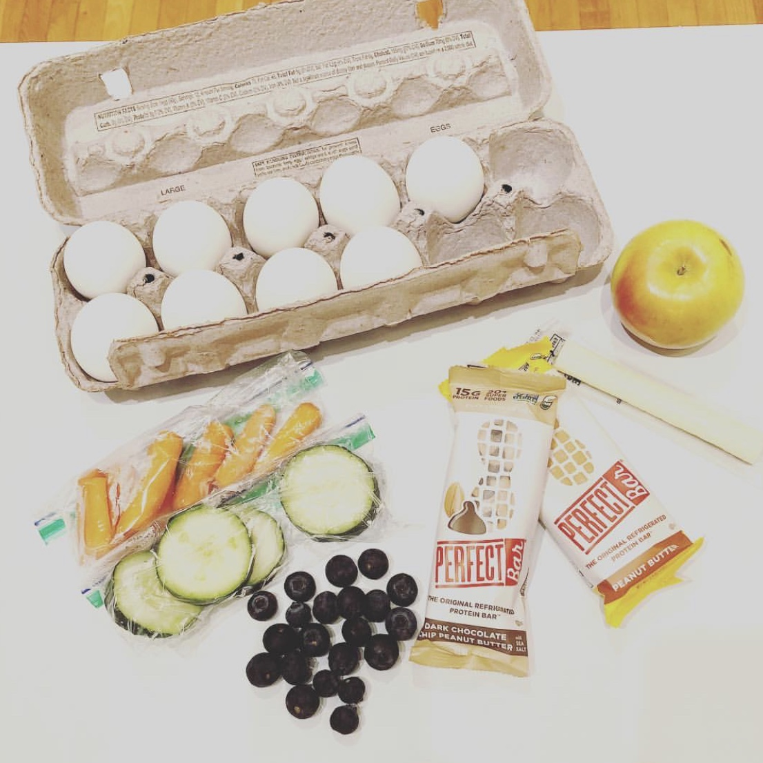 Some of Amy's go-to snacks include hardboiled eggs, Perfect Bars, carrots/cucumbers, cheese sticks and blueberries/apples.